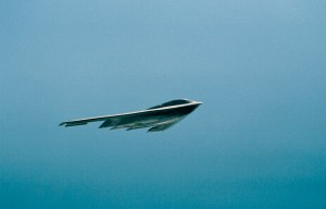 The sleek F-117A makes a speedy pass over the flight line.
