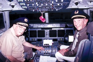 Operation Babylift pilots Ken Healy (left) and Bill Keating (right) on the flight deck of the MD-11 that made the commemorative trip back to Vietnam.