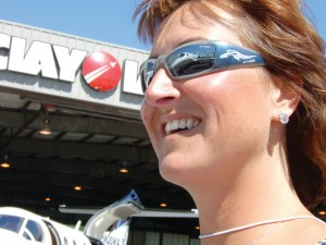Airport Journals volunteer Kelly Carroll with a business jet reflected in her glasses.