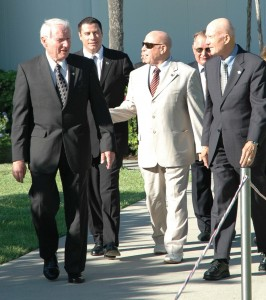 L to R: Vance Brand, John Travolta, Major General Alexei Leonov, Valery Kubasov and General Tom Stafford stroll near the Rocket Garden at the Kennedy Space Center Visitor Complex.