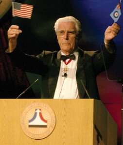 Master of ceremonies for the NAHF 2005 Enshrinement, Air Vice Marshal Ron Dick (ret.) opened the program on Saturday with some British-American humor.