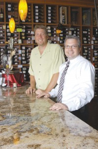 L to R: Robert Quinette has a mind for business and Bryan Criswell knows his wines. The two owners of Highlands Wineseller enjoy what they do.