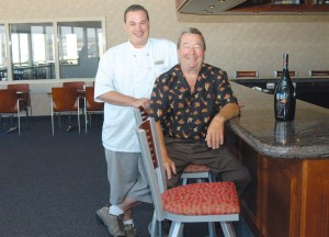 L to R: Perfect Landing owners, Sean Carter and his father, Jim Carter, next to their newly renovated bar.