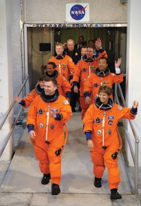 L to R: STS-114 Pilot James Kelly and Mission Commander Eileen Collins lead the rest of the mission crew out to the Astrovan that will take them to Launch Pad 39B on July 26.