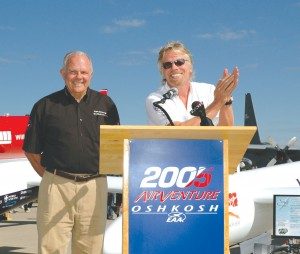 "Sir Richard Branson applauds Steve Fossett, after the announcement that the Virgin Atlantic GlobalFlyer will again take to the skies on an ""Ultimate Flight."""