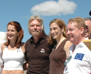 Sir Richard Branson poses with L to R: Lina Borozdina, a biochemist born in Russia who mortgaged her home for a ticket on SS2; US exobiologist Loretta Hidalgo; and Realm CEO Tom Higgins, founder of Irish Physics Live, who presented a check for his $200,00