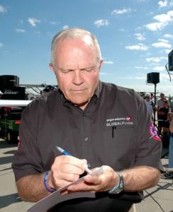 Steve Fossett spent several minutes signing autographs.