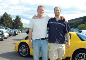 Joe Oltmann, owner of Millennium Autosport (right) in front of a Corvette with Randy Ankeney, his right hand man and general manager.