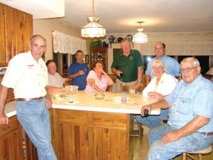 "Gathered around for an evening of catching up are, L to R: Keith Phillips, Harry Truppner, Olav van Bockel, Shirley Miller, Loran ""Tiny"" Timm, Mike Phillips, Darla Richter and Ron Miller."