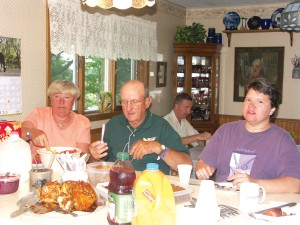 Breakfast at the Millers is informal, and healthy. Here Rautgunde, Raymond and Susan Maule share breakfast. Olav van Bockel is in the background catching up on the morning news.