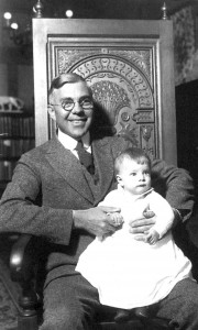 Charles C. Gates Sr. proudly holds his firstborn son, Charles C. Gates Jr.