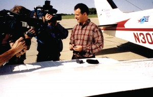 On Sept. 24, 2002, in Omaha, Douglas Cairns checks his blood sugar level in front of the media before departing on his Diabetes World Flight.