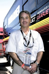 Scott Westfall beams in front of the Bombardier motorcoach at the Honda Indy 225 at Pikes Peak Raceway.