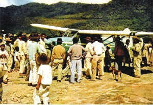"After ""Blue Bird"" landed on a plateau in the mountains of southern Mexico, Totontepec villagers clustered around the aircraft. On takeoff, the runway was so short that the plane had to drop off the edge of the plateau."