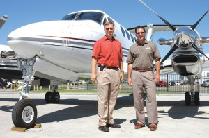 L to R: Jim Riner and Pat Searle, in front of a King Air 350, have 28 years of combined knowledge in the market, buying, selling and leasing primarily pre-owned turboprop and jet aircraft.