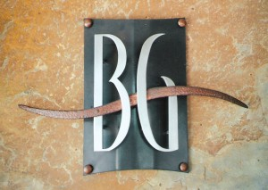 Stainless steel and hammered copper are the primary elements of the corporate logo for Briargate on Main, an apartment complex in the Parker area.