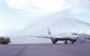 The first airplane painted in the new US Airways' colors receives a water cannon salute upon arrival at Phoenix Sky Harbor International Airport.