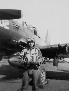 "Fred Blechman in full flight gear and G-suit in front of his F4U-5 Corsair while in the VF-14 ""Tophatters"" fighter squadron in late 1950."