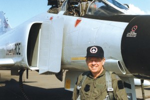 Dressed in military flight gear, David Hinson prepares to pilot an F-4 Phantom while visiting an Air National Guard base in Portland, Ore., circa 1984.