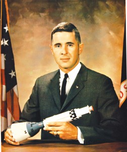 William A. Anders poses with a model rocket for his first official NASA portrait in 1964.