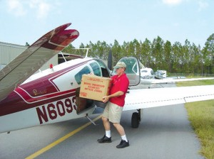 While in Slidell, La., Pat Shaub, partner in Eagle Training Solutions, unloads supplies from Lago Vista Airport.