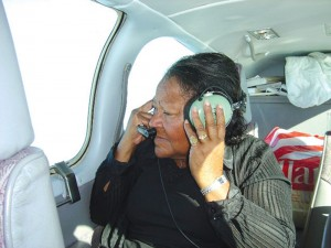 Azalea Johnson watches out the window on the flight to Monroe.