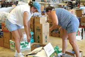 Volunteers lend a hand.