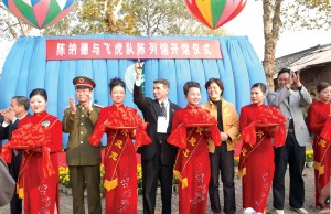 SAAHF director Jeff Greene cuts a ceremonial ribbon during the official opening of the Flying Tiger Museum at Zhi Jiang, China, on Nov. 15, 2003.