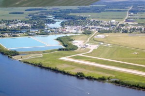 Along with its land runways, Baudette International Airport offers a water runway in the adjacent Rainy River (foreground). Arriving seaplanes can clear Canadian Customs on the other side.