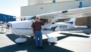 Rick Craddock next to his Cessna 172SP, sponsored by Daedalus Aviation, a premier flying club at Front Range Airport.