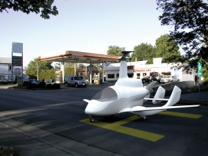 Since the CarterCopter will use auto gas, you could set it down and drive into a gas station to fill up.