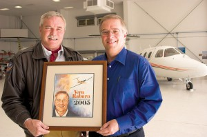 Jerry Lips presented Vern Raburn, president and CEO of Eclipse Aviation, with the Aviation Entrepreneur of the Year award for 2005.
