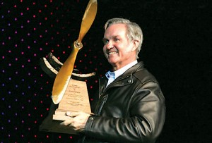 "Burt Rutan received the Wings Over the Rockies' prestigious ""Spreading Wings"" award November 12 before 800 Denver area aerospace enthusiasts."