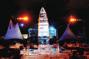 """A six-foot ice sculpture of SpaceShipOne dominated the reception area. Also on display were a Burt Rutan-designed Adam M-309 and a flying machine from """"Around the World in 80 Days,"""" honoring his Voyager and GlobalFlyer achievements."""