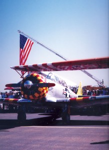 An AT-6 in the markings of the Tuskegee Airmen was on static display during the flag ceremony.