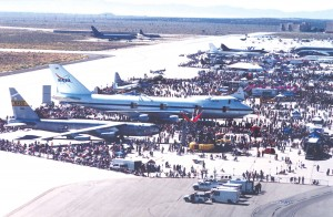 Spectators fill the Edwards AFB flight line, viewing a large array of aircraft and other exhibits on display.