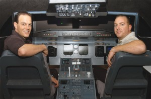 L to R: Travis Barnett, president of Atlas Airline Academy, and Jesse Schoonover, CEO, in their Canadair Regional Jet 200 simulator.