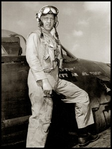 Naval aviator Bill Daniels stands on the wing of a Grumman F8F Bearcat in this post-World War II photograph.