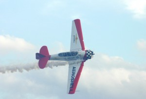 Flying through his own smoke, Gene McNeely makes a photo pass in his AeroShell Aerobatic Team AT-6 Texan.
