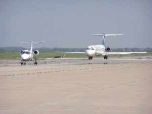 "Two commercial aircraft taxi for takeoff at Salina Municipal Airport, ""America's Fuel Stop."""