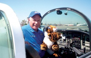 Grumman Tiger pilot and owner Ron Millman poses with his tiger mascot.