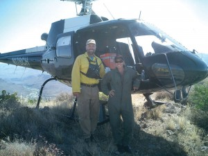 R to L: Desiree Horton poses with Don Sharlow, helicopter manager of the Cave Creek Complex fire, near Carefree, Ariz. The fire covered more than 150,000 acres in Arizona.