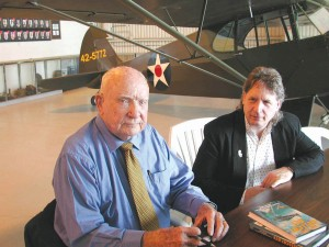 "Cdr. Hamilton ""Mac"" McWhorter signed his book, ""The First Hellcat Ace,"" after speaking. With him is SCF VP Scott MacWilliams."