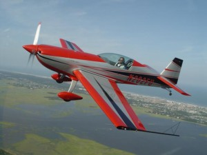 The Extra 300LP displays its beauty and graceful lines as its pilot enjoys some non-competition stick time. Also evident is the expansive and unobstructed cockpit view.