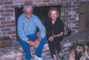 "Gloria Winters relaxes in front of the fireplace with her husband, Dean Vernon, and her German shepherd, ""Happy."" Vernon passed away in 2001."