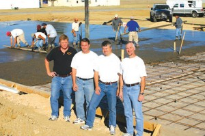 L to R: Kurt Sehnert, Darin Hart, Tim Elliott (president) and Bryan Hurley at the site of American Legend Aircraft Company's new facility, which will house the company's aircraft production operations and a new customer delivery center.