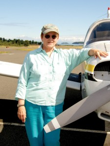 Audrey Wells rents a Piper Warrior for Mercy flights. In the distance is Sucia Island, off the end of Runway 34 at Orcas Island Airport (ORS), Eastsound, Wash.