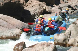 Donny guides our raft through Arkansas River rapids in Colorado's Royal Gorge. Courtesy Rapid Image
