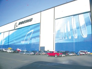 The Boeing plant's giant doors, where new planes are rolled out to the paint hangars, now sport images of the future 787 airliner.