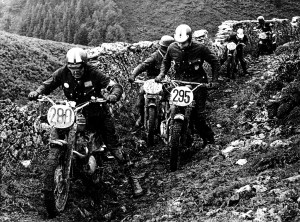 John Steen and Ed Kretz Jr. (right) try to negotiate the muddy trail at the 1965 International Six-Day Trials on the Isle of Man.